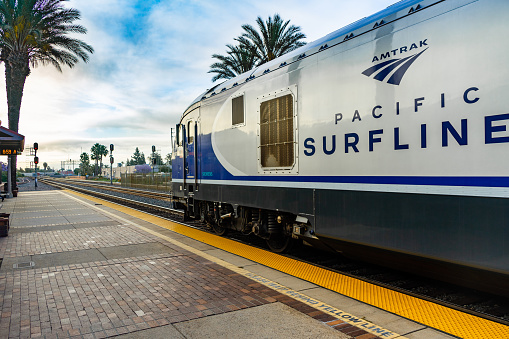 Fullerton, CA / USA – May 25, 2019: Amtrak Surfliner train stopped at the Fullerton, California train Station which is located at 120 East Santa Fe Avenue.