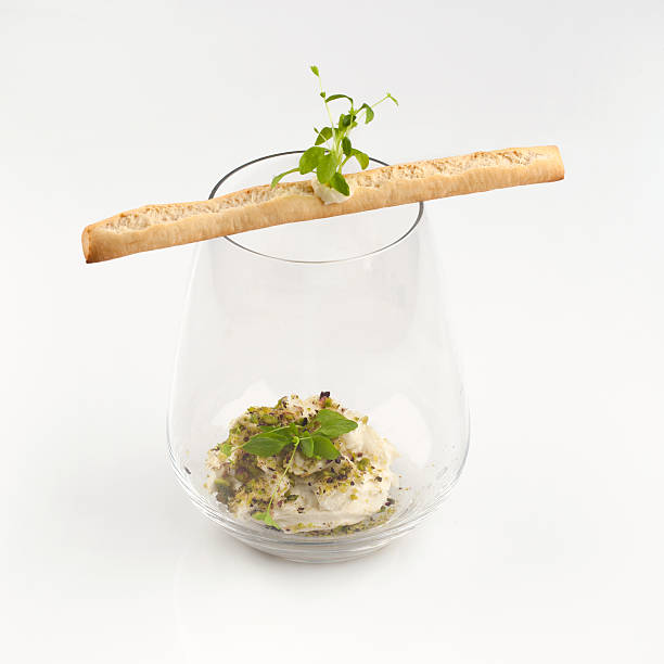 Amuse bouche Amuse bouche in glass with watercress amuse stock pictures, royalty-free photos & images