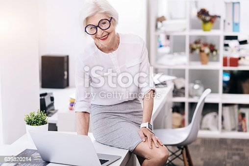 istock Amused funny business lady using the device in the office 639820214