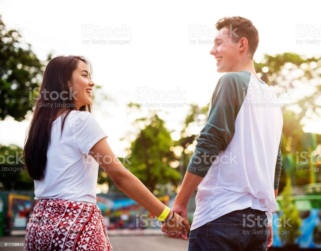 Amusement Park Carnival Dating Holding Hands Concept stock photo