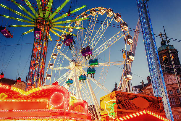 amusement park carousel amusement park carousel ferris wheel stock pictures, royalty-free photos & images