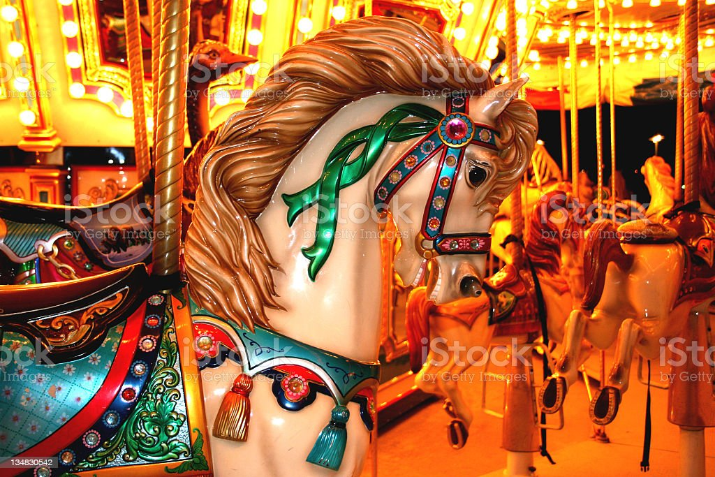 Amusement park carousel ride. Night. Horses. Colorful. stock photo