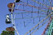 istock Amusement park. ferris wheel at blue sky. Color cabins 1316629663