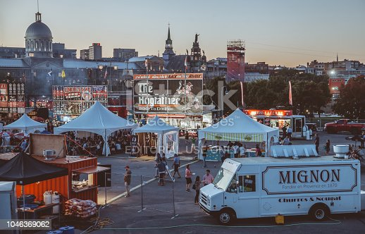 September 14th 2018,Montreal,Canada: Tourists and locals having good time in an amusement park by the St.Lawrence River in Montreal,Canada.Food trucks and cityscape can be seen in the backgrounds.