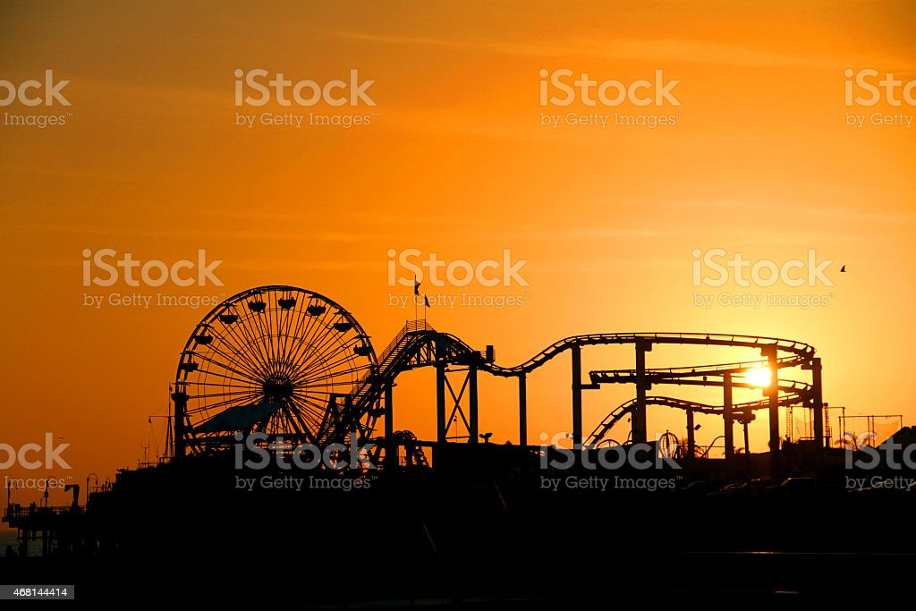 Amusement Park near by the Beach and Sunset stock photo