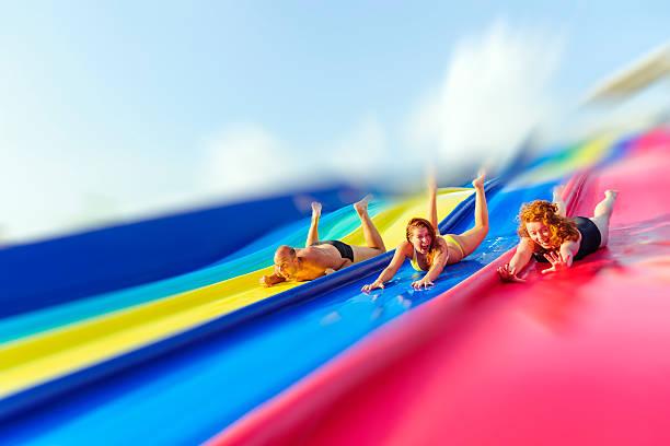 amusement park - sliding stock photos and pictures