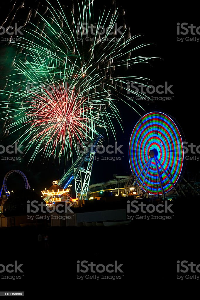 amusement rides and fireworks stock photo