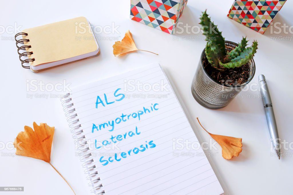 ALS Amyotrophic Lateral Sclerosis written in notebook stock photo