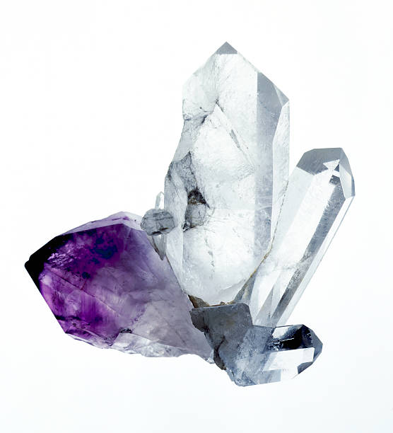 Amythyst & Quartz crystals A group of amythyst and quartz crystals isolated on a white background. Originaly shot 5x4 film stock. stone object stock pictures, royalty-free photos & images