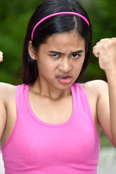 An A Female Youngster And Anger A person in an outdoor setting antagonize stock pictures, royalty-free photos & images