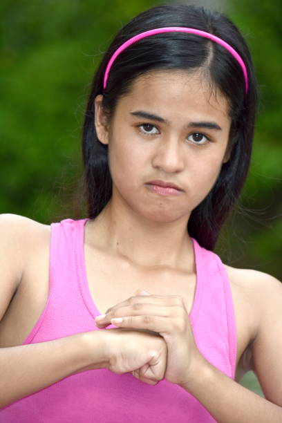 An A Filipina Girl And Anger A person in an outdoor setting antagonize stock pictures, royalty-free photos & images