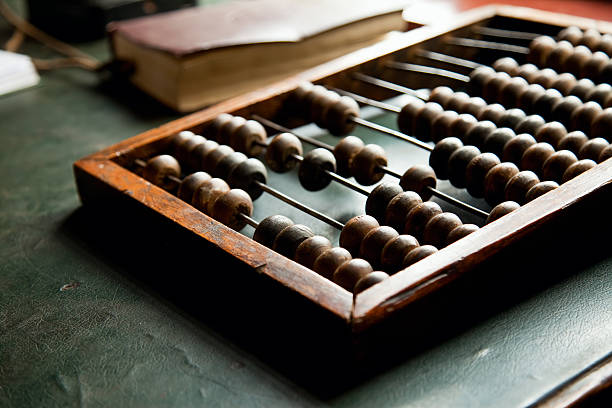 an abacus laying on a green table - abakus bildbanksfoton och bilder