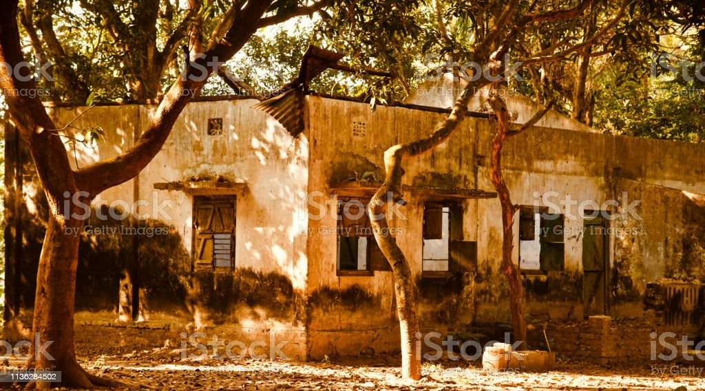 An abandoned house around an urban place stock photo