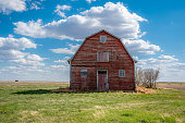 An abandoned red barn on the prairies in Saskatchewan, Canada