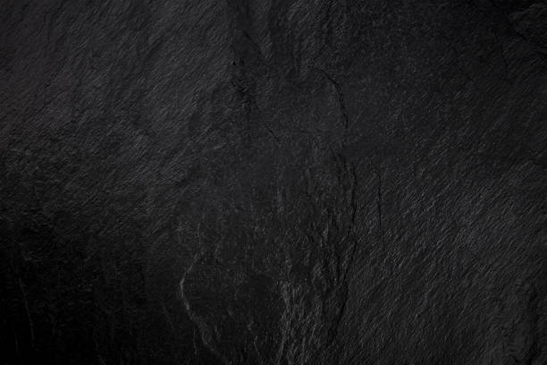 An abstract black slate background, a dark texture with a place for text stock photo