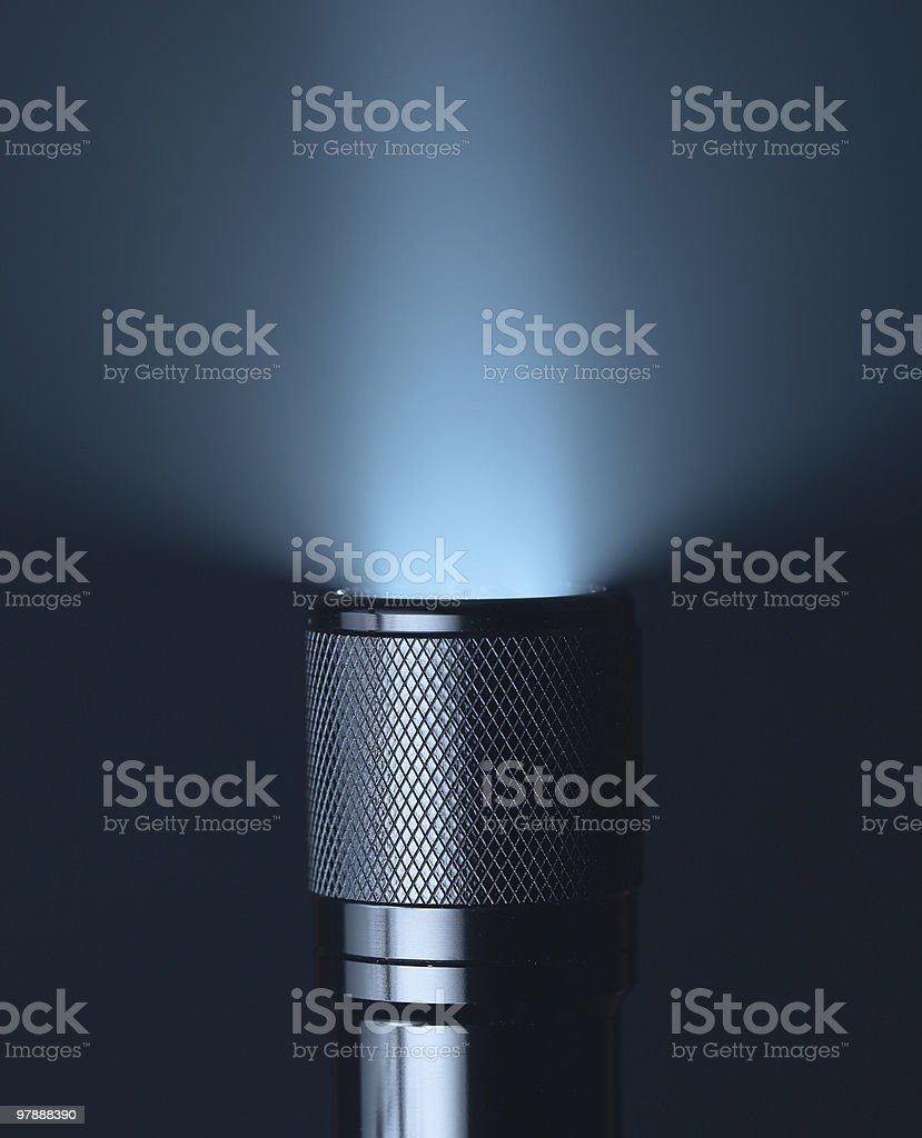 An abstract light beam coming from a torch on a black back stock photo