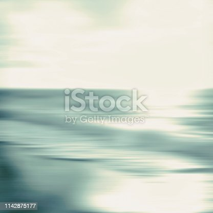 An abstract ocean seascape with blurred panning motion. Image displays a retro vintage look with cross-processed colors.