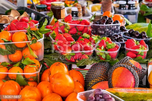 An abundant variety of ripe cherries, strawberries, tangerines and persimmons. The traditional Mediterranean diet consists of natural and fresh products, including fruits, vegetables and grains. Image in high definition format.