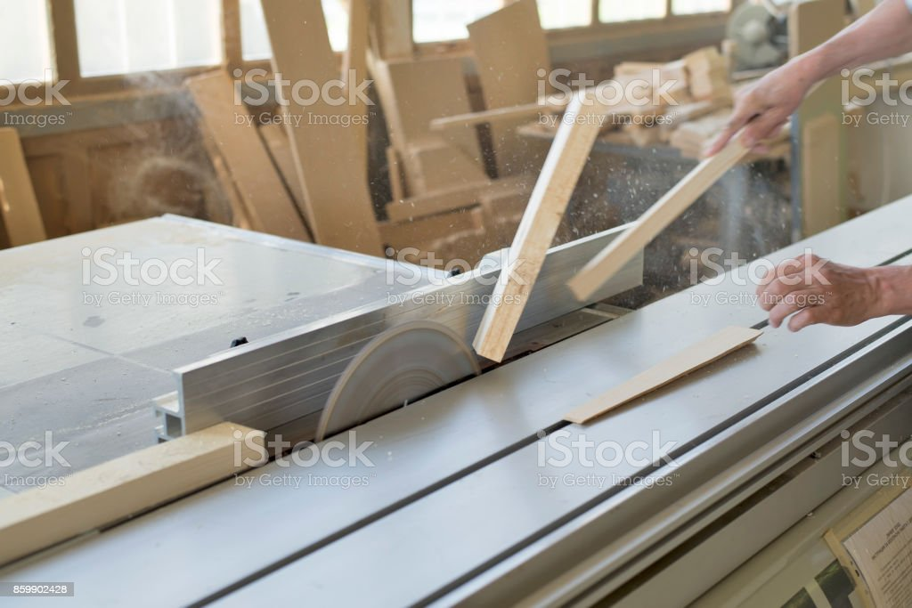 An accident at work. Carpenter cuts on a circular saw. stock photo