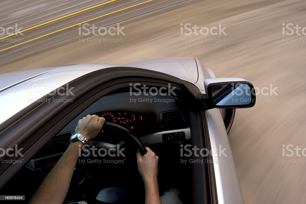 An action shot of a man turning a car royalty-free stock photo
