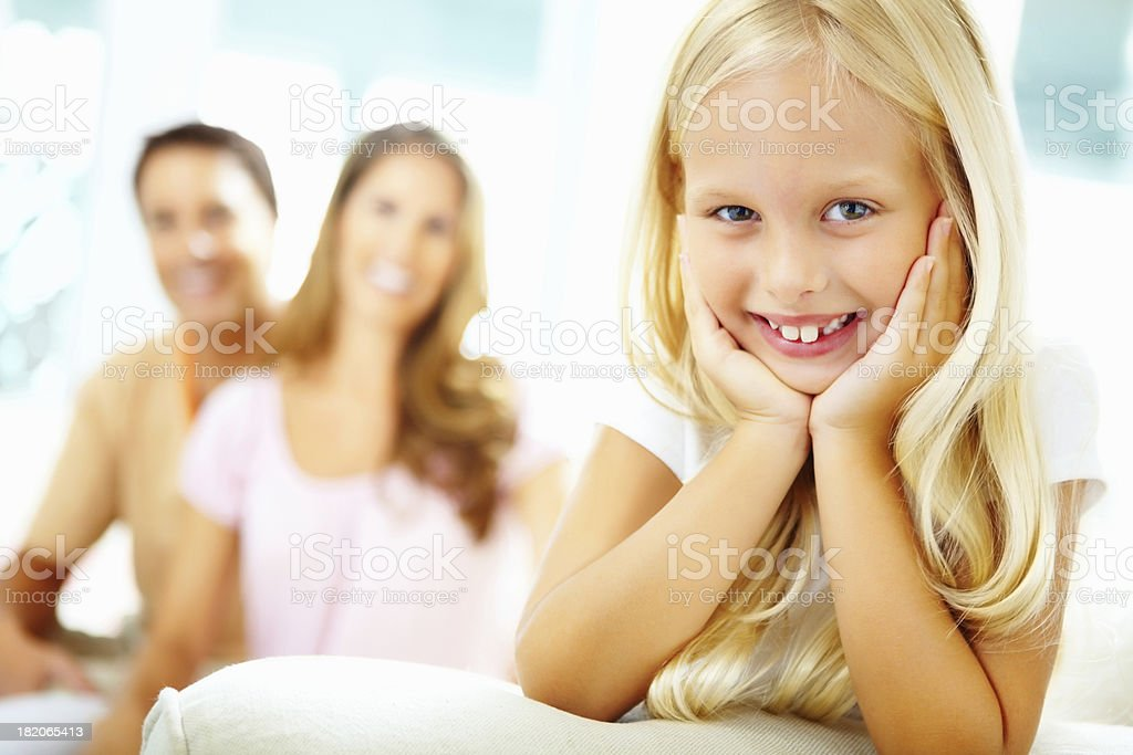 An adorable young girl with blurred parents royalty-free stock photo