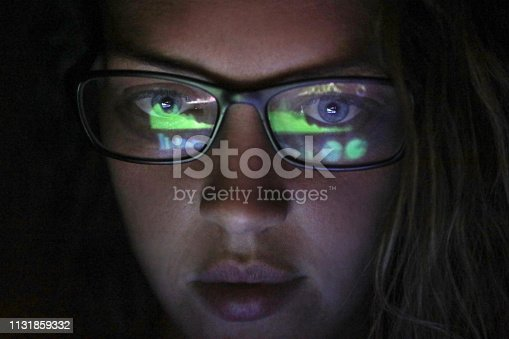 istock an Adult female looking at financial graphs on a laptop. 1131859332
