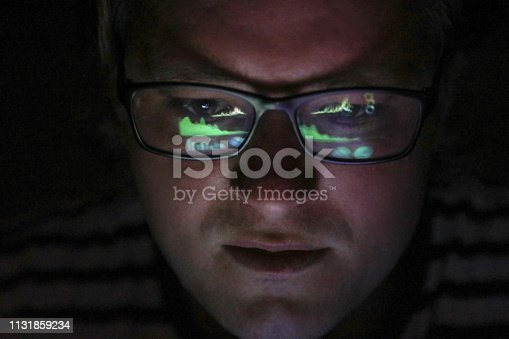istock an Adult male looking at financial graphs on a laptop. 1131859234