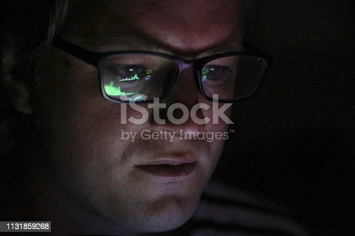 istock an Adult male looking at financial graphs on a laptop. 1131859268