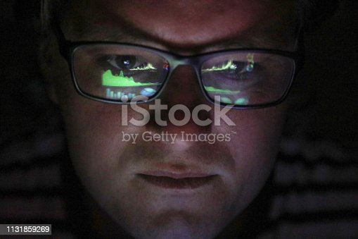 istock an Adult male looking at financial graphs on a laptop. 1131859269