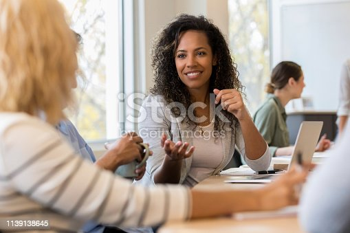 An adult African American woman explains her position on the proposal during the annual meeting of high school teachers.