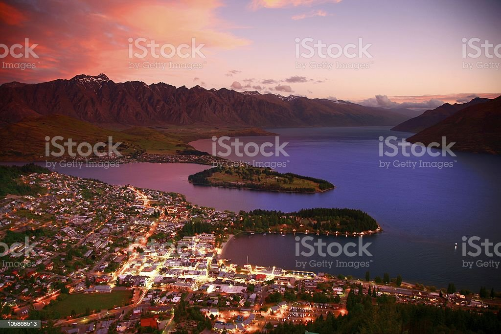 An aerial view of a city by waster at sunset stock photo