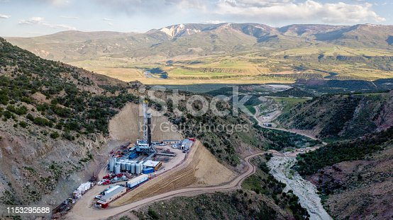 An amazing drone view of a drill rig perched on the side of a mountain in Colorado in the Springtime