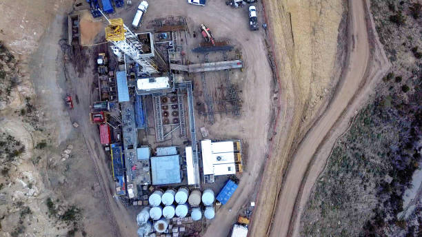 An Aerial View Of A Fracking Drill Rig On The Side Of A Mountain In Colorado In Late Spring stock photo