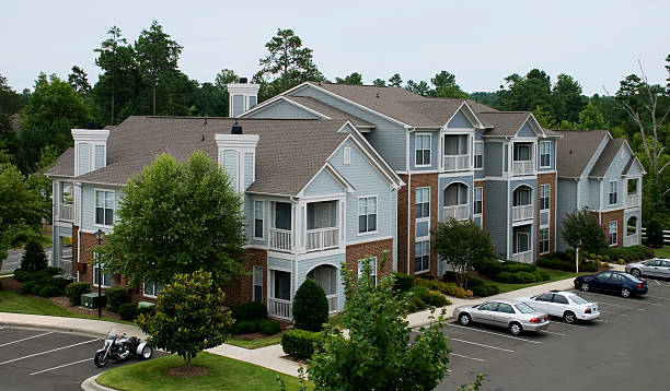 An aerial view of a nice apartment complex  Cute apartment building with a forest in the background. townhouse stock pictures, royalty-free photos & images