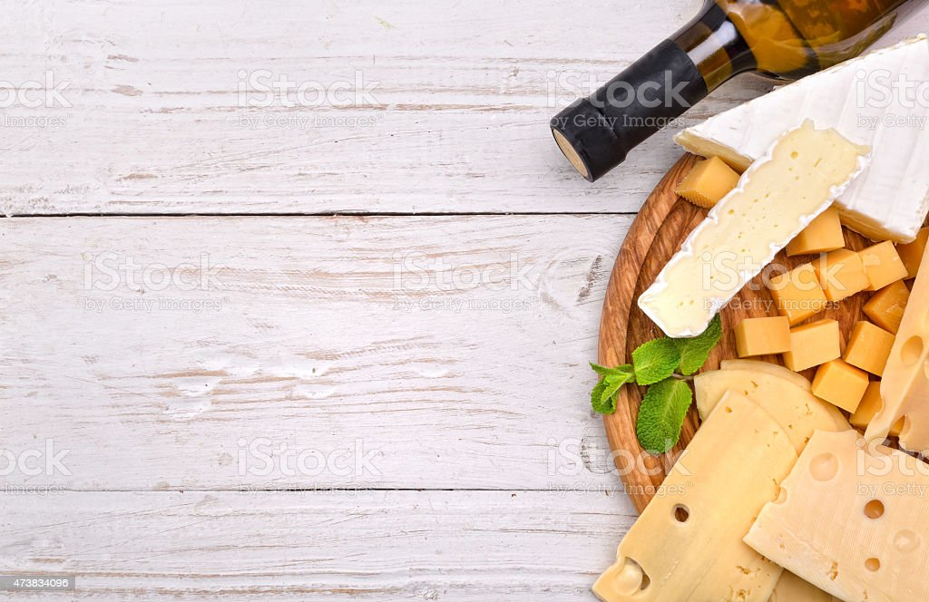 An aerial view of a platter of various cheeses on a table stock photo