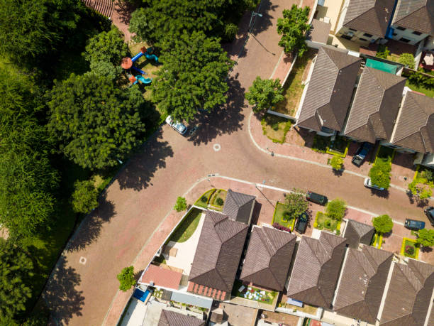 An aerial view of houses of a gated community An aerial view of houses of a gated community un Guayaquil, Ecuador. Shot with a drone in a sunny day looking straight down. gated community stock pictures, royalty-free photos & images