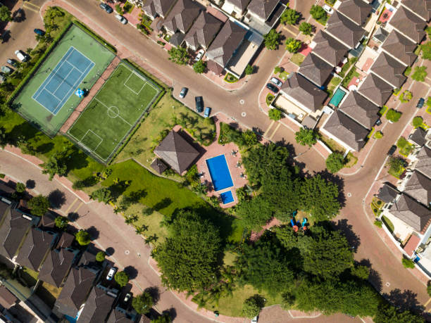 An aerial view of houses of a gated community An aerial view of houses of a gated community un Guayaquil, Ecuador. Shot with a drone in a sunny day looking straight down.An aerial view of houses of a gated community un Guayaquil, Ecuador. Shot with a drone in a sunny day looking straight down. gated community stock pictures, royalty-free photos & images