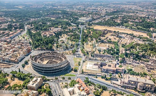 On the sky of one the most beautiful and ancient cities in the world. Aerial view of the Coliseum (Amphitheater Flavium), the Celio Hill and the Roman Forum, the FAO building.
