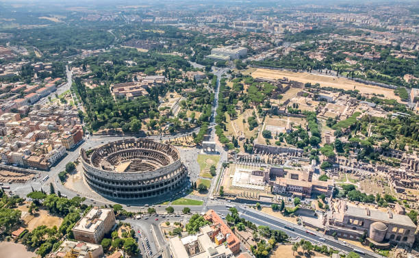 An aerial view of the Coliseum and the Palatine Hill in the Roman Forum On the sky of one the most beautiful and ancient cities in the world. Aerial view of the Coliseum (Amphitheater Flavium), the Celio Hill and the Roman Forum, the FAO building. coliseum rome stock pictures, royalty-free photos & images