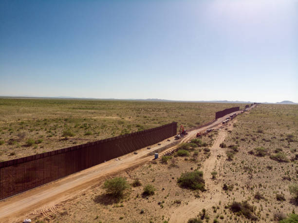 An Aerial View Of The International Border Wall With Portions Still Under Construction The Internation Border Wall with sections that are still under construction international border barrier stock pictures, royalty-free photos & images