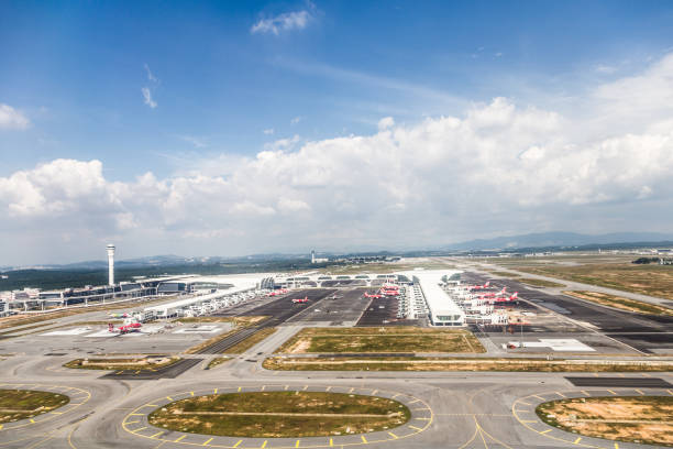 An aerial view of the KLIA 2 airport in Malaysia Kuala Lumpur, Malaysia - January 17, 2017: An aerial view of the KLIA 2 airport, which is the hub of the low coast airline AirAsia in Malaysia. kuala lumpur airport stock pictures, royalty-free photos & images