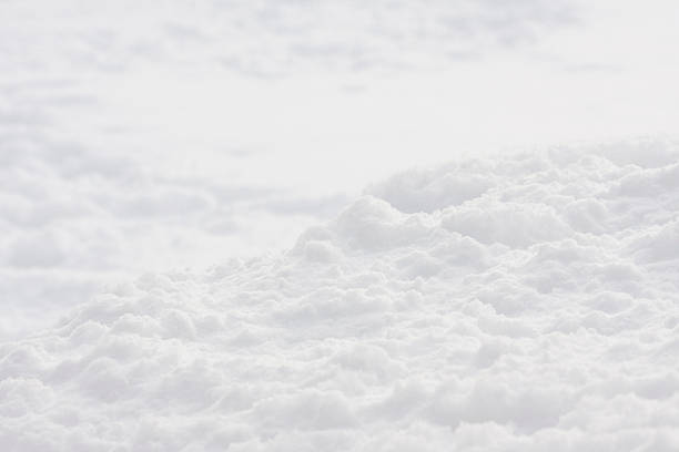 an aerial view of white clouds - snow pile stock photos and pictures