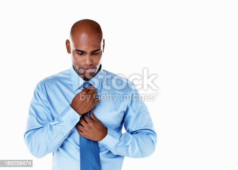 istock An African American business man adjusting necktie against white 183259474