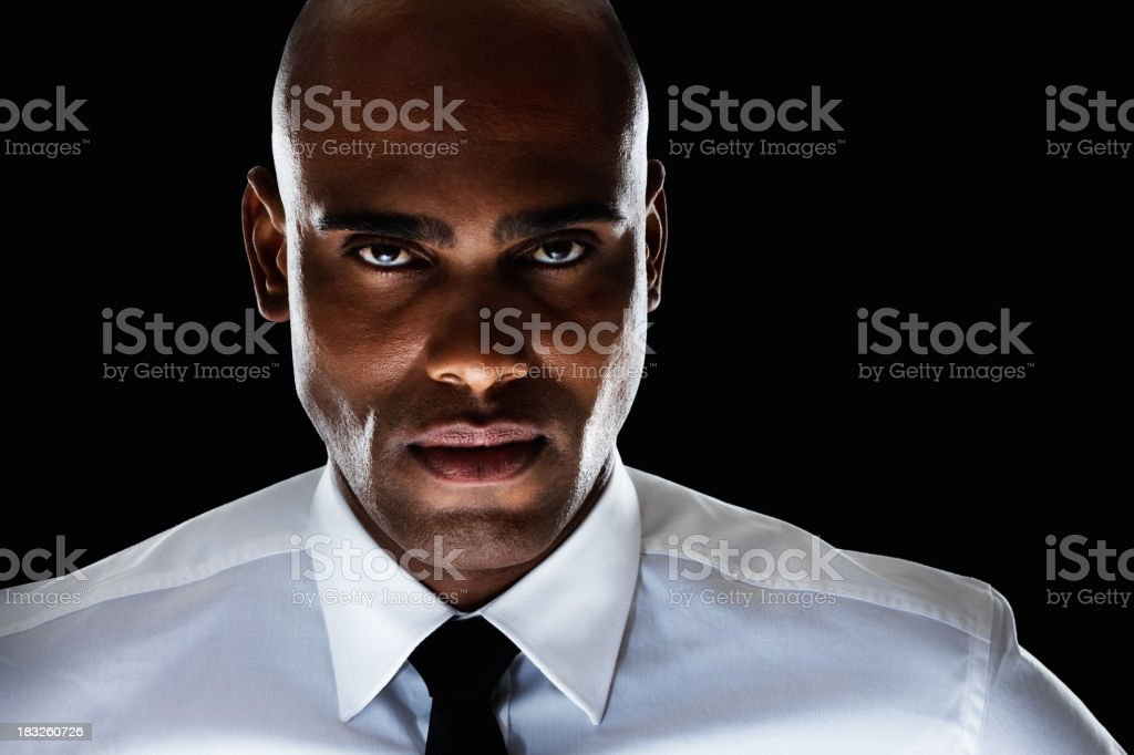 An African American business man against black - copyspace stock photo
