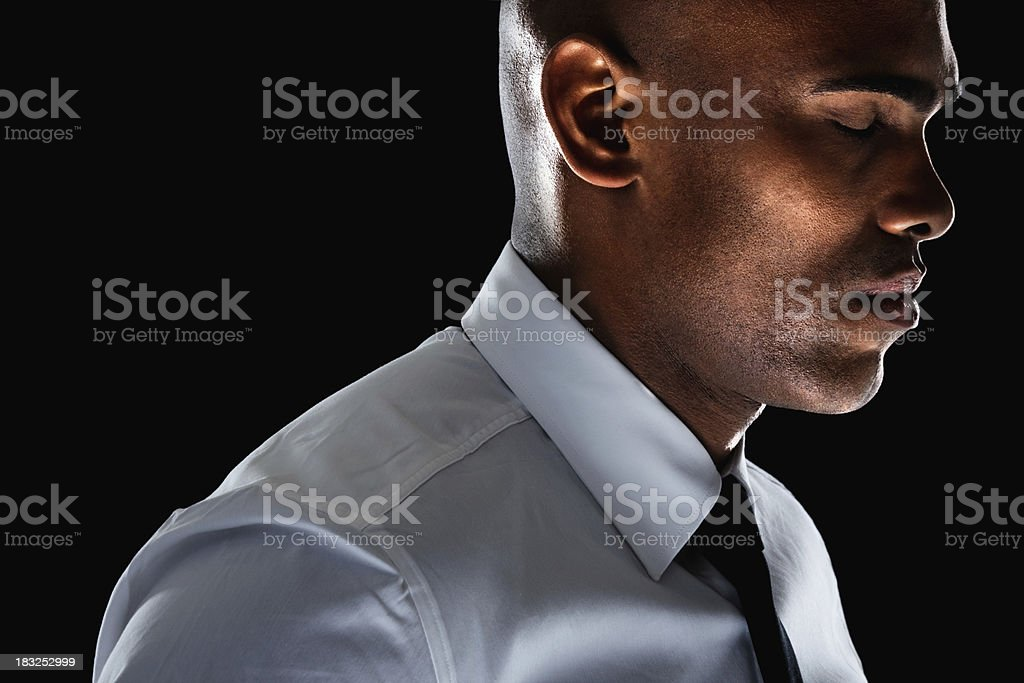 An African American business man with eyes closed against black royalty-free stock photo