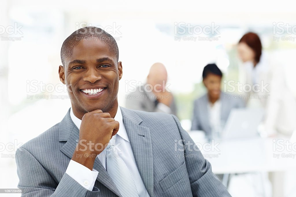 An African American business man with people in the background stock photo