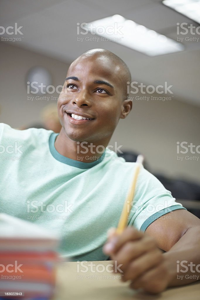 An African American male paying attention in class at college royalty-free stock photo