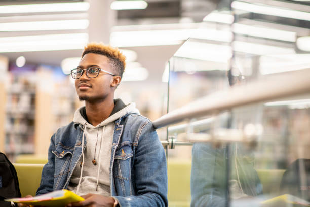 An African American University Student Studying in the Library stock photo stock photo