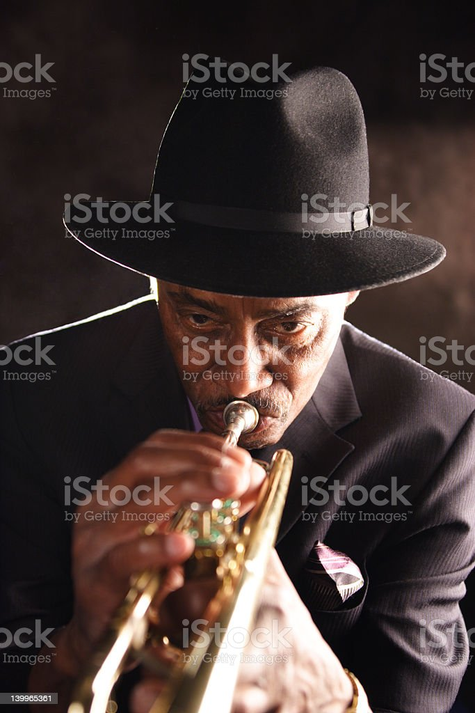 An African male playing a trombone in Bourbon Street stock photo
