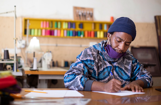 African fashion designers at work in their studio in Kayamandi informal settlement near Stellenbosch South Africa.